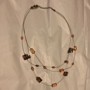 Pink stones on silver tiered necklace